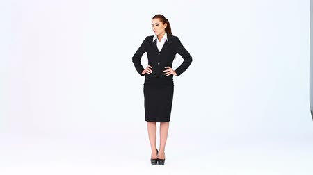 рука : Young business woman standing at white background Стоковые видеозаписи