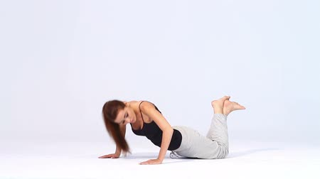 hareketli : Cute woman doing exercises on white background