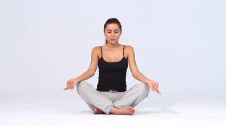 душа : Cute woman doing yoga on white background