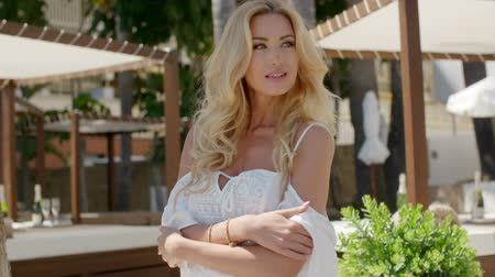 elegancia : Close Up of Attractive Blonde Woman with Long Wavy Hair Wearing White Peasant Blouse at Resort