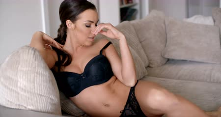 calcinhas : Pretty Woman in Black Lingerie Sitting on Couch