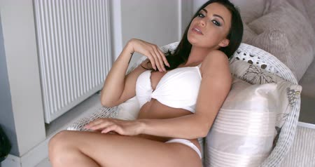 bra : Woman in White Underwear Relaxing on a Chair Wideo