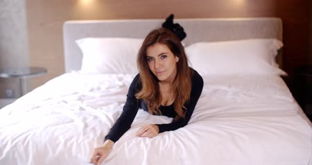 sock : Beautiful Young Woman Lying on Her Bed