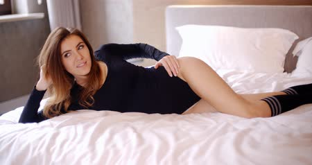sock : Adorable and Pretty Young Girl Lying on Bed