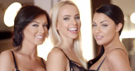 bra : Three happy smiling sexy girl friends