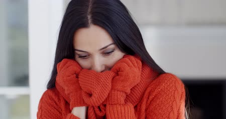 cold : Serious young woman in winter fashion Stock Footage