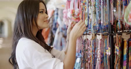 clothing : Brunnette Woman Shopping For Clothing
