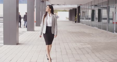 eleganckie : Grinning optimistic professional woman walking