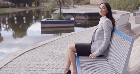 bank : Business woman relaxing near canal