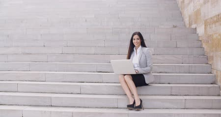проект : Business woman with laptop on stairs