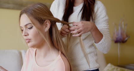 braid hairs : Pretty Woman with a Friend Fixing her Blond Hair