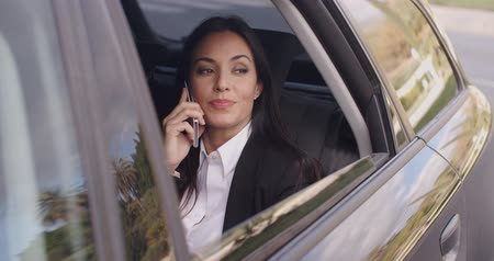 Beautiful business woman on phone in automobile Wideo