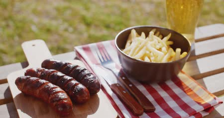 grillowanie : Three tasty smoked grilled sausages with chips