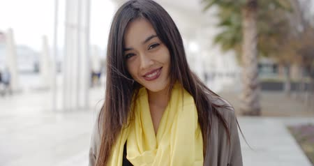 başörtüsü : Joyful grinning woman outside in yellow scarf