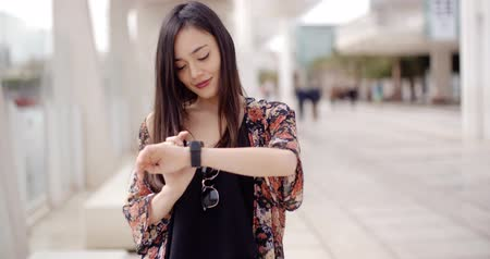 детеныш : Young woman checking her wristwatch