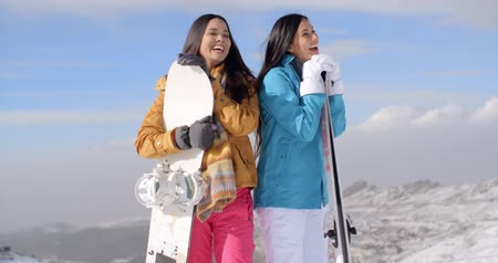 snowboard : Two young woman with their snowboards Stok Video
