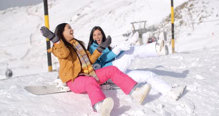 holidays : Two happy young women enjoying a winter holiday