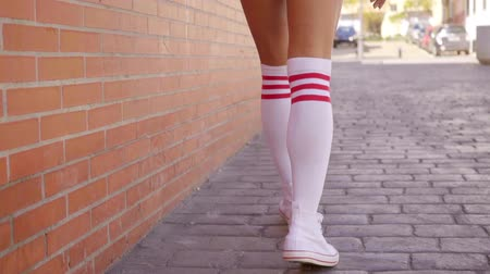 sock : Close Up Of Womans Legs In White Knee-High Socks
