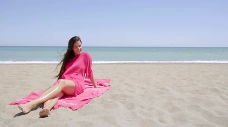 temporadas : Graceful young woman sunbathing on the beach Stock Footage