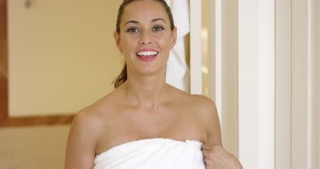 towel : Happy woman holding towel around herself Stock Footage