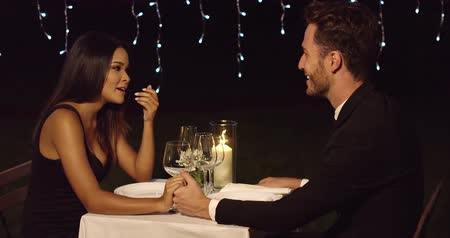 vacsora : Loving young couple enjoy a romantic dinner Stock mozgókép
