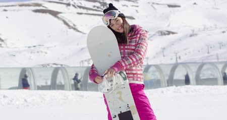 snowboard : Pretty young asian woman holding snowboard