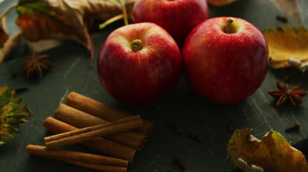 canela : Red apples and cinnamon with anise on dark wooden table