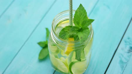 бакалейные товары : From above drinking jar with fresh beverage containing lime and mint on blue wooden background