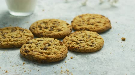 few : Closeup shot of sweet crunchy chocolate chip cookies lying on table with crumbles around Stock Footage