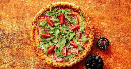 oregano : Tasty pizza on a rusty background with spices, herbs and vegetables. Top view.