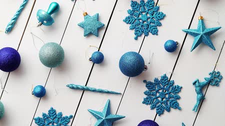 floco : Christmas blue collection, balls and decorative ornaments, on white wooden background.