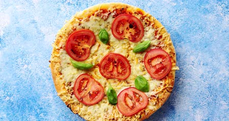 rokfor : Italian pizza with cheese tomatoes and basil on blue stone table