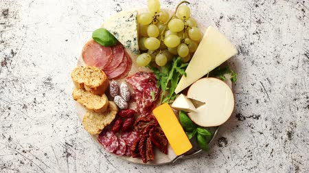 antipasti : Assortment of spanish tapas or italian antipasti with meat, ham, olives, cheese, nuts and bread placed on a white rusty table. Top view flat lay with copy space background