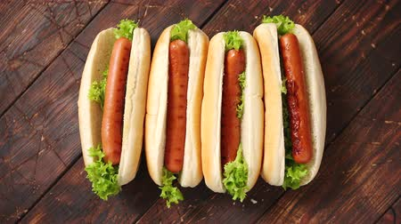 pies : Tasty american hot dogs assorted in row. Placed on wooden table. Above view on a rustic wood background