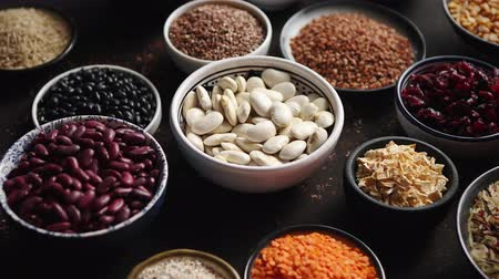 super bowl : Various superfoods in smal bowls on dark rusty background. Superfood as rice, lentil, beans, peas, goji, flaxseed, buckwheat, couscous, chickpeas Above view Flat lay