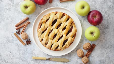 baking dishes : Tasty sweet homemade apple pie cake with cinnamon sticks, walnuts and apples on side. Placed on stone background with copy space.