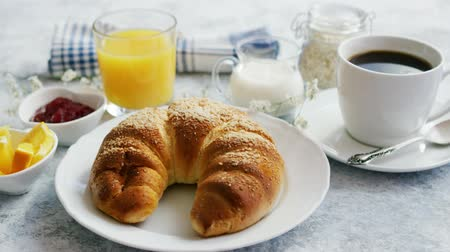 marmelada : Served breakfast with baked golden croissant and jam with glass of orange juice on marble table