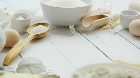 nakrycie stołu : Assorted ingredients for pastry preparation and cooking tools lying in circle on white timber tabletop