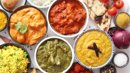 tikka : Assorted Indian various food with spices, rice and fresh vegetables on white wooden table. Flat lay. Top view.