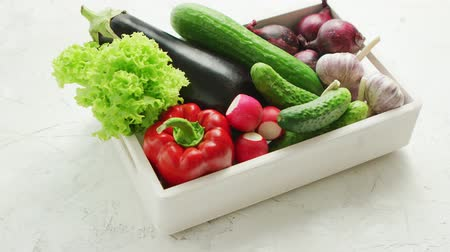 vitamin : From above of box filled with various fresh vegetables in daylight