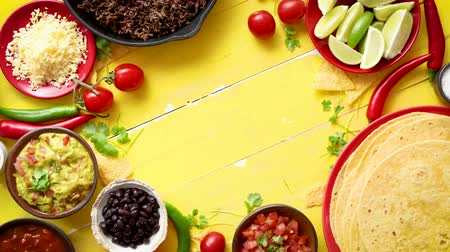 taco : Delicious Chilli con Carne ingredients waiting to be prepared. Placed on yellow wooden table. Top view with place for text in the middle.