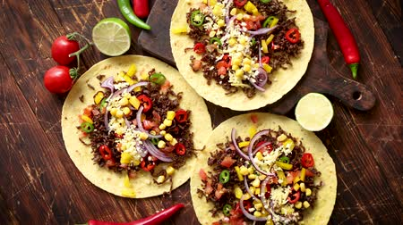 taco : Healthy corn tortillas with grilled beef, fresh hot peppers, cheese, tomatoes over rusty wooden table background, top view, copy space. Mexican food contept.