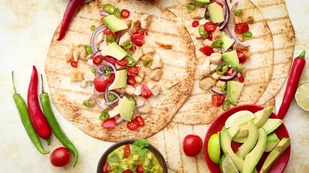 taco : Freshly made healthy corn tortillas with grilled chicken fillet, big avocado slices, fresh salsa, limes and differend sides. Placed on rusty table. Healthy food, gluten-free, allergy-friendly, weight loss concept