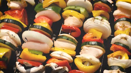 appetizing shish kebab : Colorful and tasty grilled shashliks on outdoor summer barbecue. Garden party idea