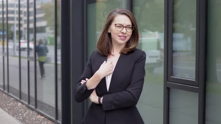 сложить : Portrait of a beautiful confident female executive, looking into the camera. She standing outside her business office.
