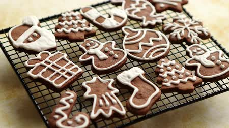 Fresh baked and prepared Christmas shaped gingerbread cookies placed on steel grill frame on a table. View from above.