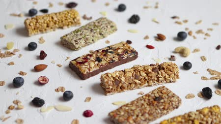 Composition of healthy raw dessert snack. Fitness dietary food. Homemade protein energy natural bars on the rustic white stone board. Vegetarian nutrition concept. Copy space.