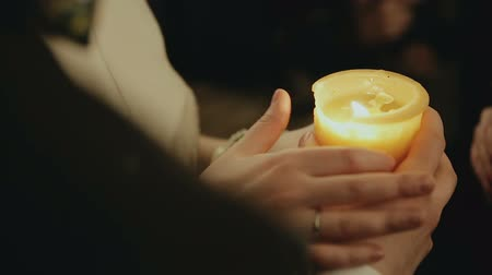 věčnost : Bride and groom lighting up a candle as a symbol of love