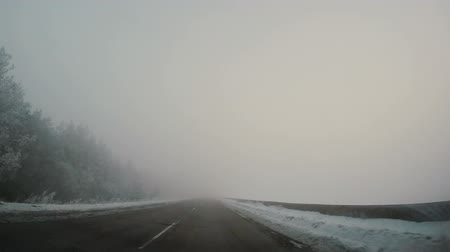 Driving car in winter in fog Stok Video