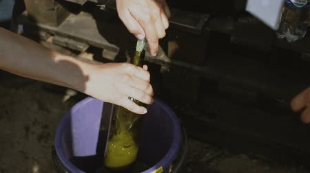 homemade wine making. pouring wine in a bottle Stock mozgókép